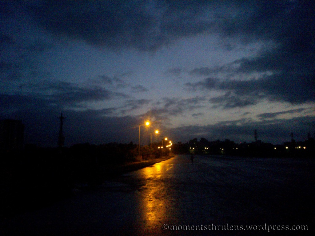 Street Light reflection on road at early morning 6 AM....Clicked as Landscape.
